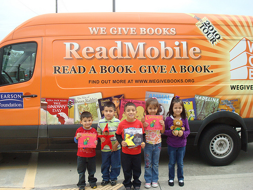 we give books, pearson, kids reading and donating, caught in the act of reading, http://PragmaticMom.com