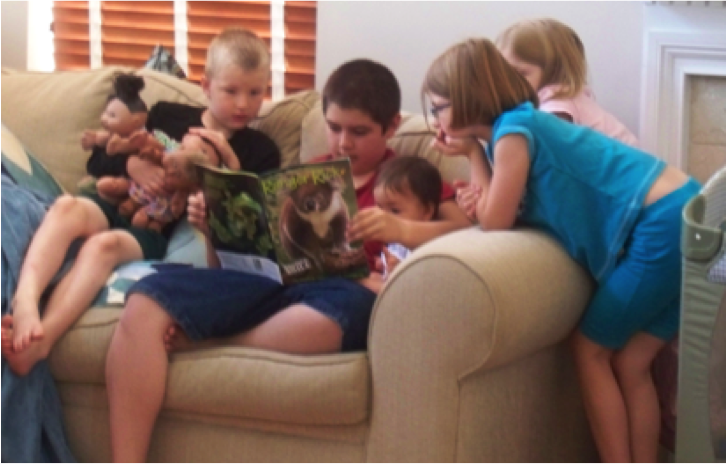 5 kids reading on couch, caught in the act of reading, http://PragmaticMom.com