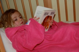 girls reading in snugglies, http://pragmaticmom.com, caught in the act of reading