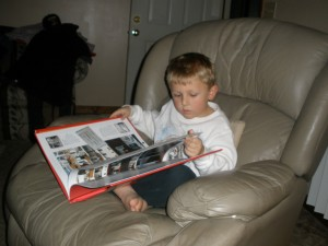 caught in the act of reading, kathleen ellison, kevin reading about boats, http://PragmaticMom.com, PragmaticMom