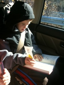 caught in the act of reading, pragmatic mom, cute kids reading