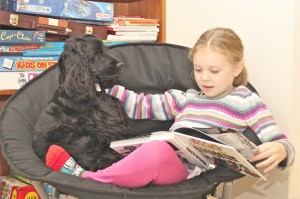 Caught in the act of reading issie reading with her dog pragmatic mom
