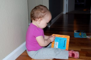 Littlebug reading, caught in the act of reading, pragmaticmom.com