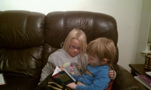 eli and ellie reading, caught in the act of reading, pragmatic mom