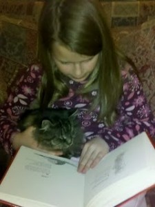 encourage kids children to read to pets dog cat pragmaticmom pragmatic mom caught in the act of reading