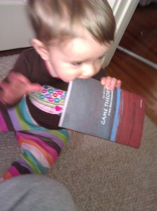 baby reading and chewing on math book Pragmatic Mom Quincy Tutoring