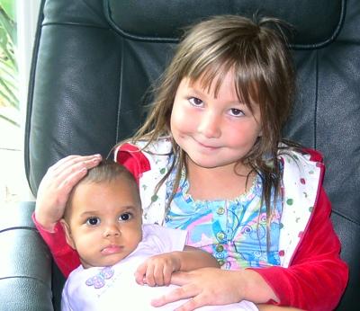 child holding baby babycarebasics.net pragmaticmom.com