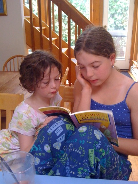 Caught in the Act of Reading Pragmatic Mom two sisters reading together
