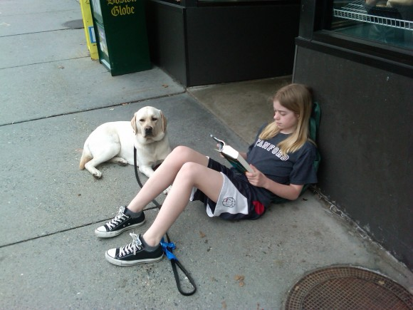 girl reading with dog golden labrador author Karen L Day caught in the act of reading Pragmatic Mom