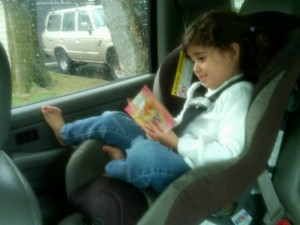 caught in the act of reading pick up time waiting in the car pragmatic mom pragmaticmom http://PragmaticMom.com, literacy, how to get kids children to read love to read