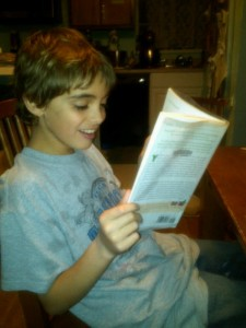 Caught in the Act of Reading Pragmatic Mom PragmaticMom boy reading mom's parenting book