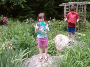 caught in the act of reading pragmatic mom kids reading in garden