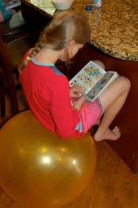 Caught in the act of reading on yoga ball PragmaticMom Pragmatic Mom