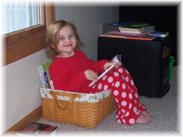 Tori caught in the act of reading pragmatic mom pragmaticmom child reading in reading basket cute girl