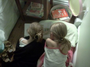 Caught in the Act of reading sisterly love PragmaticMom