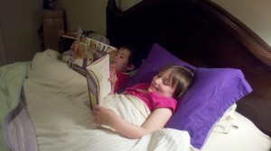siblings reading in bed caught in the act of reading pragmatic mom pragmaticmom best mom blog