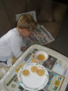 caught in the act of reading kevin kathleen pragmatic mom pragmatic mom aquent boy reading funnies comics sunday morning paper
