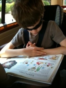 Caught in the Act of Reading with sunglasses cool kid Pragmatic Mom