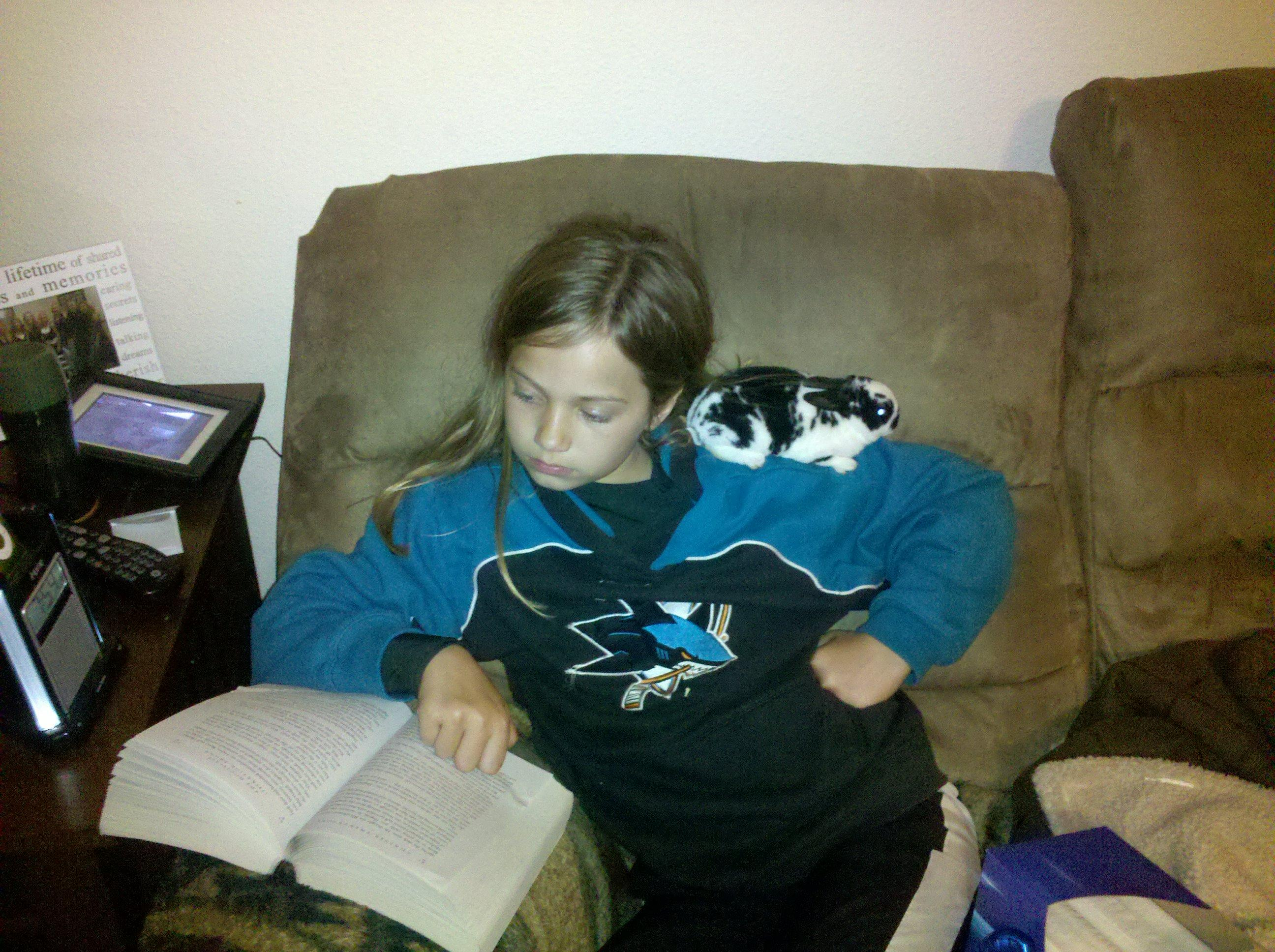 caught in the act of reading cute kids reading pragmatic mom pragmaticmom girl reading with bunny rabbit on her shoulder