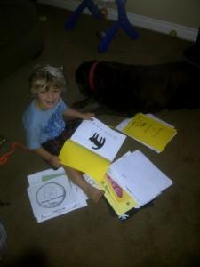 boy reading with dog