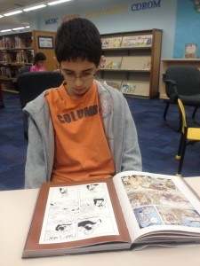 kids caught in the act of reading, graphic novel and boys