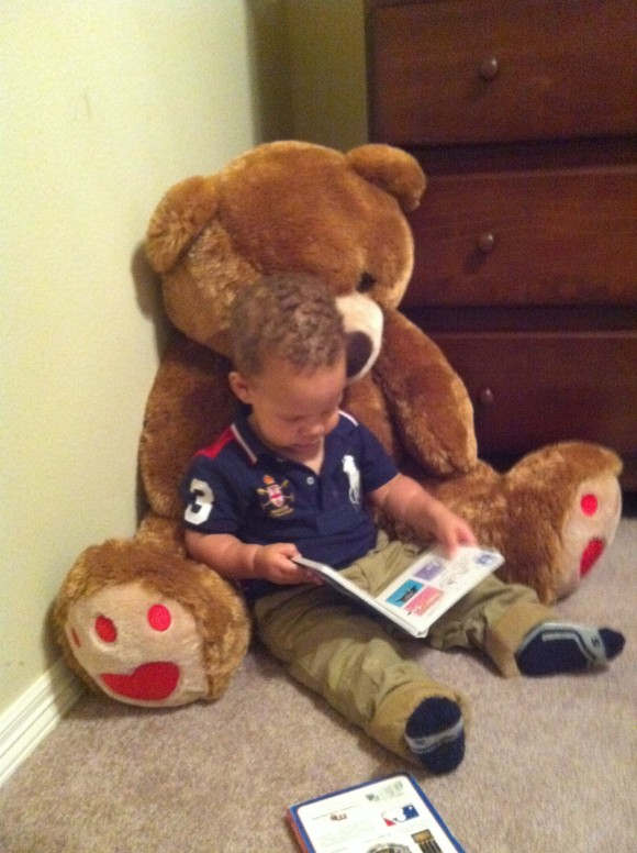reading with giant teddy bear, caught in the act of reading