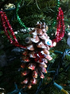 pinecone homemade ornament, christmas tree ornament craft for kids using pine cones, reindeer ornament craft for kids
