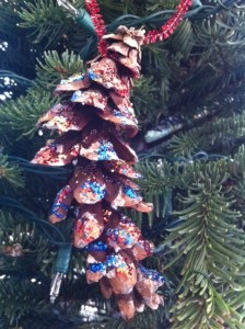 pinecone homemade ornament, christmas tree ornament craft for kids using pine cones, ornament craft for kids
