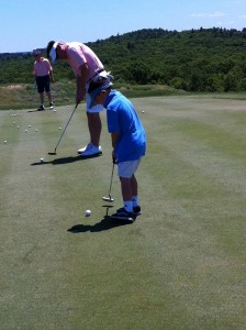 dad and son golf