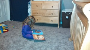 reading to stuffed animal