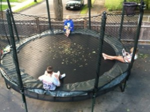 kids reading on trampoline