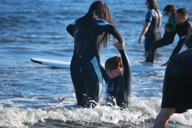 volunteering at special surf night in maine