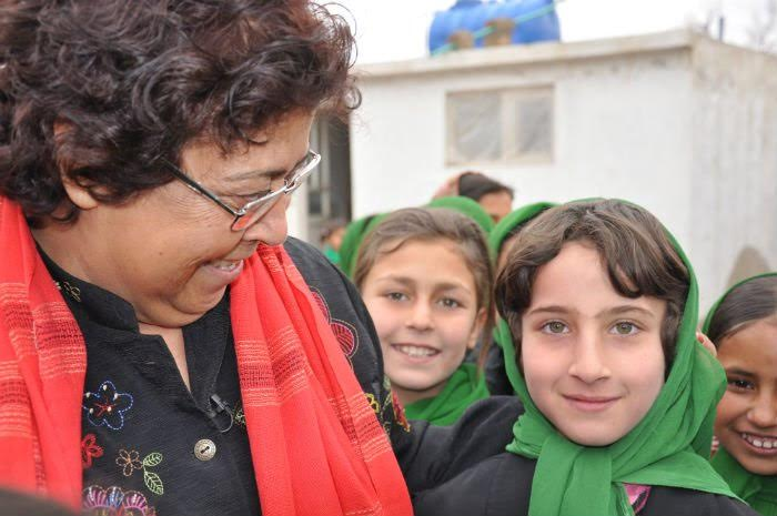 Courageous school founder & humanitarian, Razia Jan, and her students in Afghanistan