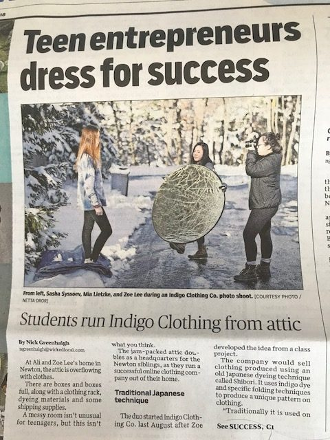 Indigo Clothing Company on front page of newspaper