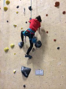 Ali rock climbing