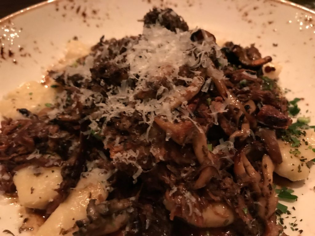 gnocchi with braised short ribs, ragout of mushrooms and parmesan cheese